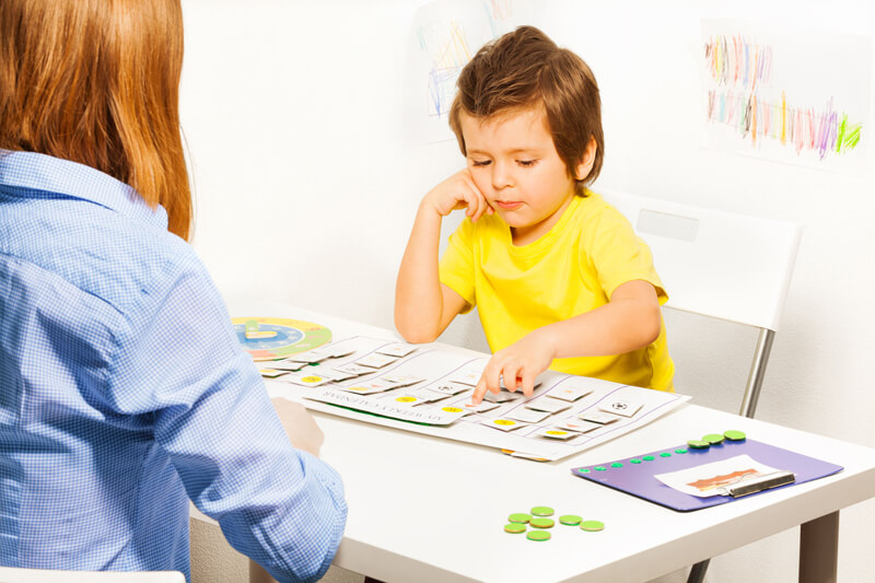 Boy uses low tech communication board