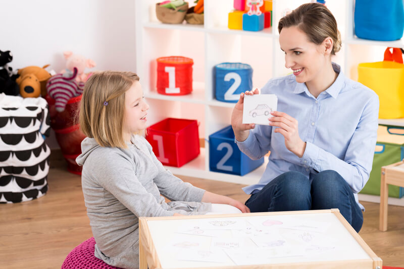 Therapist shows cards to child